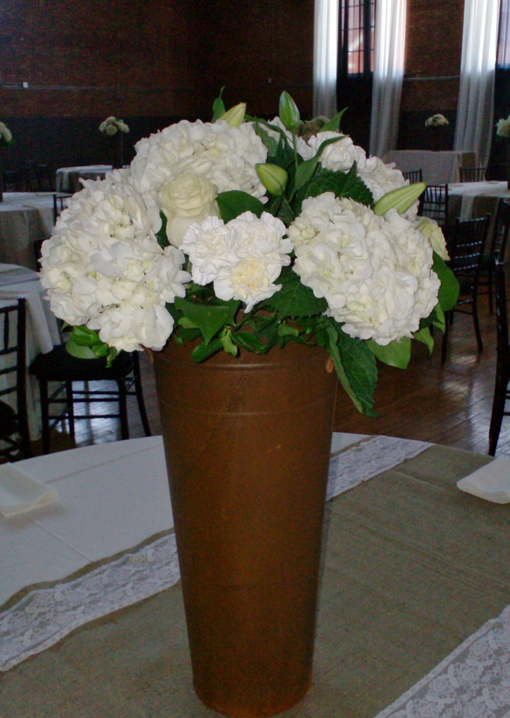 All white flowers in a rusty tin bucket sitting on a lace and burlap all white flowers in a rusty tin bucket sitting on a lace and burlap table runner mightylinksfo Gallery