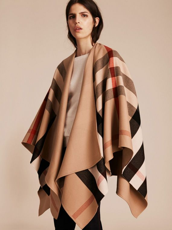 3c6d830da A Burberry merino wool poncho designed to adapt to your style, with a check  side and solid colour reverse. Particularly light and soft, it can be worn  ...