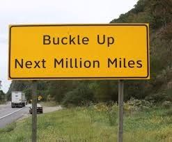sign saying buckle up next million miles