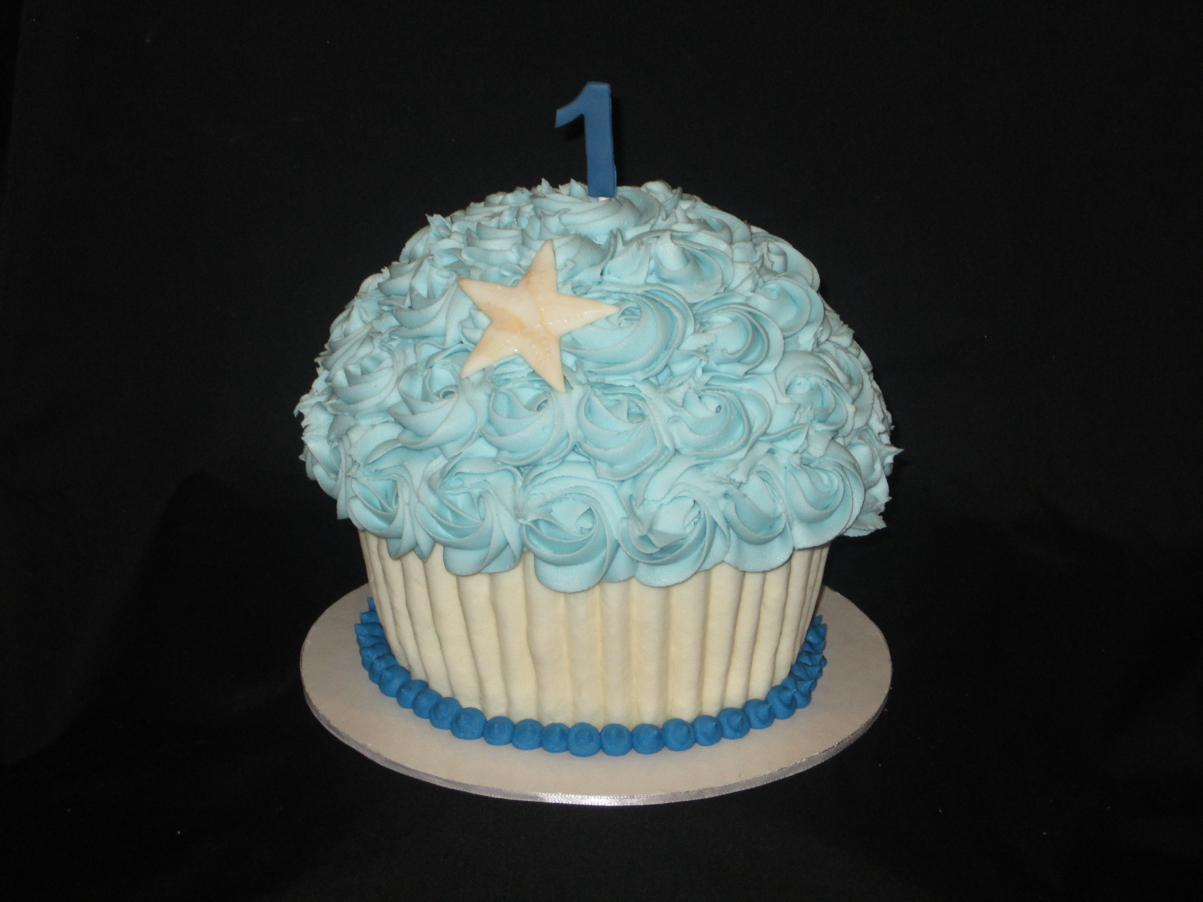 Giant Cupcake smash cake ready to be smashed during a photo session