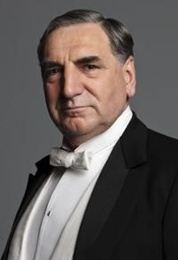 Charles Carson played by the great Jim Carter ist the head of the staff and butler at Downton. Carson is a man who takes his job seriously. He is very strict about the standards at Downton, and gets really upset whenever they are disrupted or breached by his coworkers. However, he does have a deep respect and admiration for the Crawley family. Mrs. Hughes accuses him of worshiping them. Despite his stern exterior, he shows almost fatherly concern for his coworkers.
