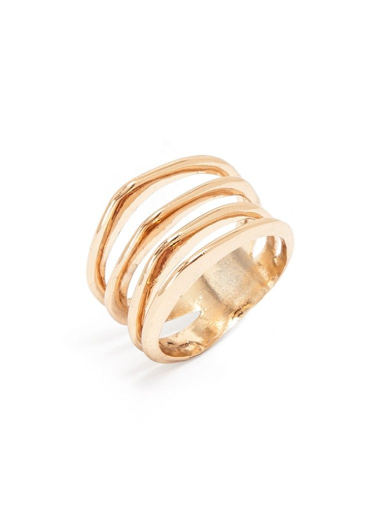 Four slightly uneven pointed ridges extend from this ladder ring finished in glam gold for an extraterrestrial effect.