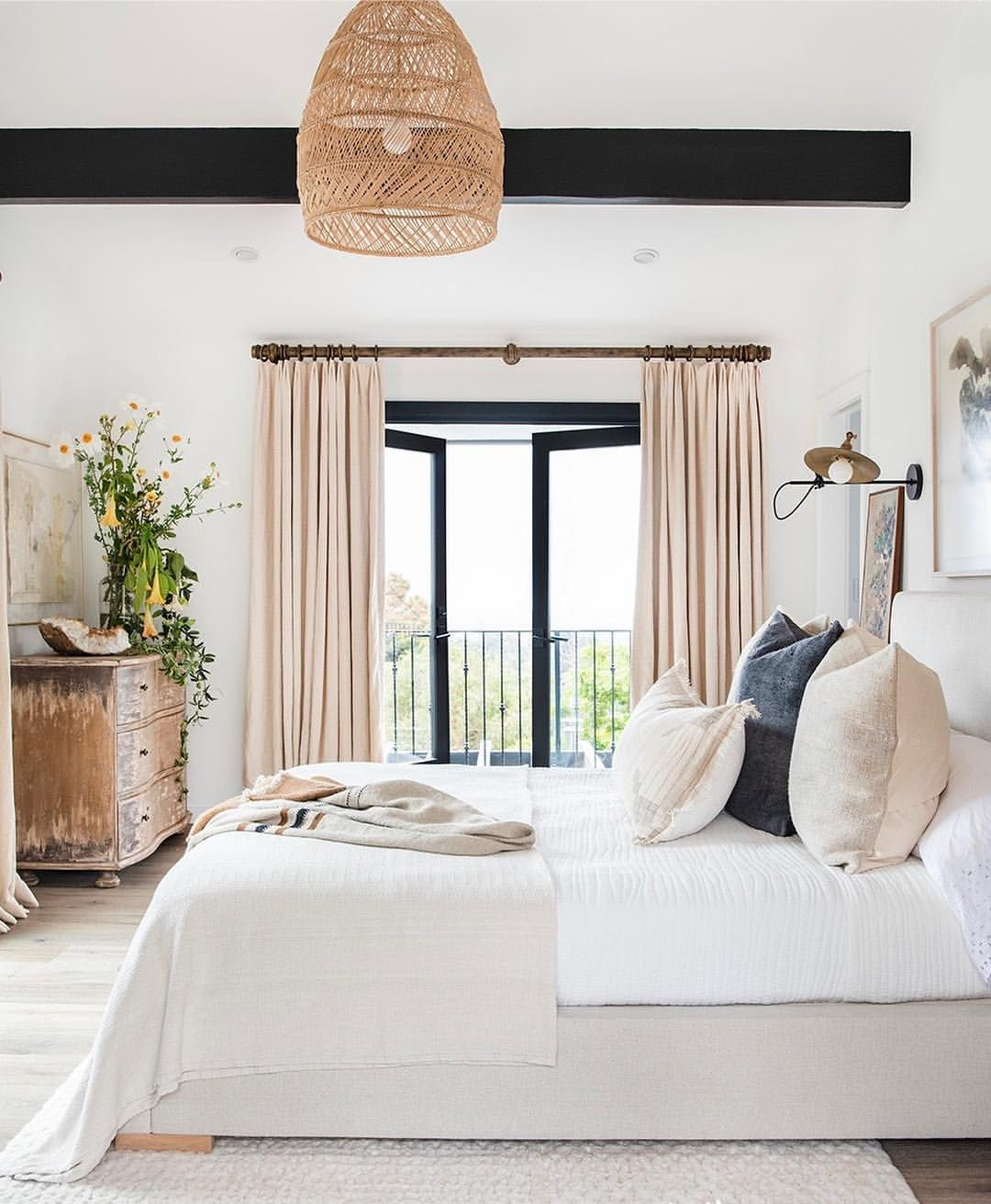 Soft organic master bedroom with ceiling beams  Beautiful bedroom