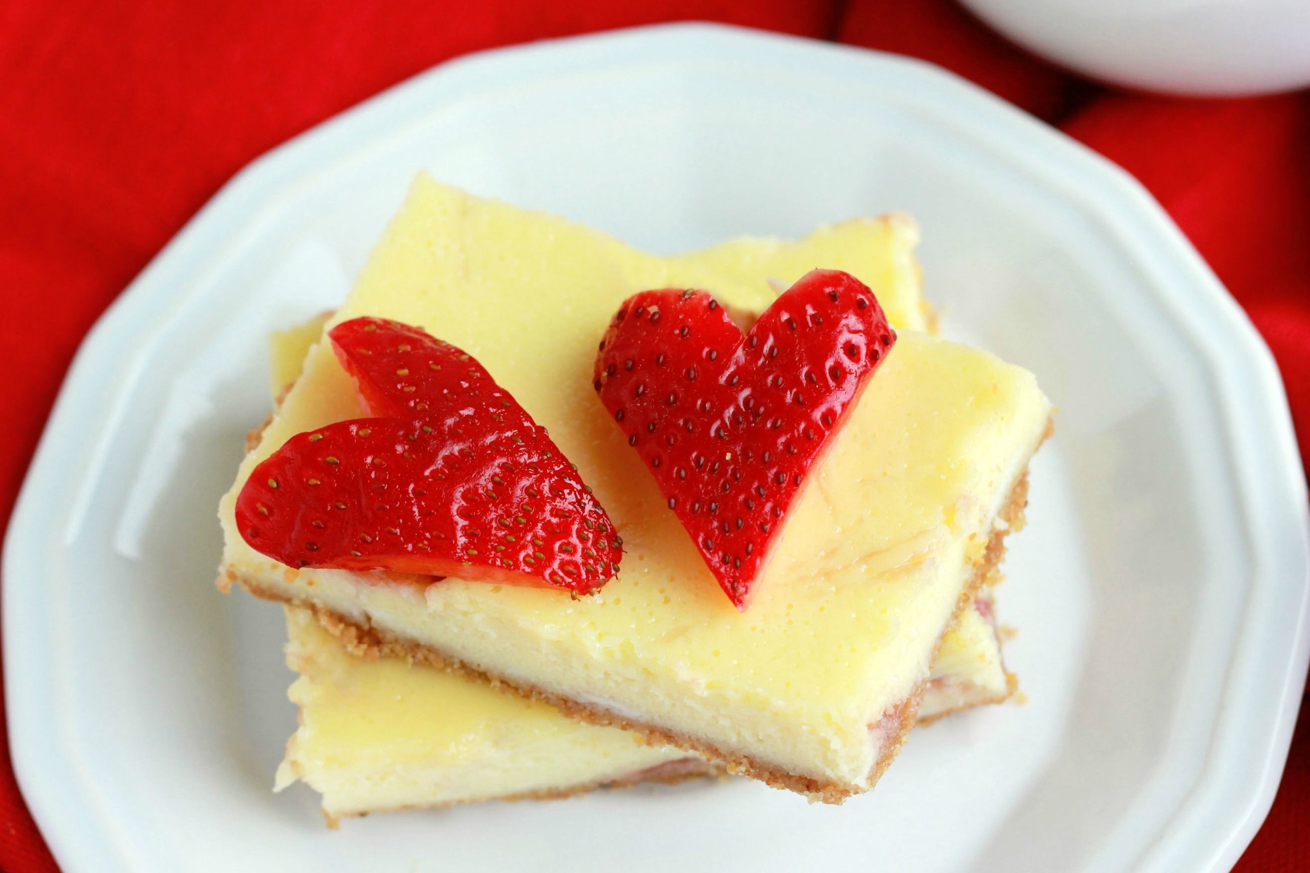 These Strawberry Cheesecake bars take less than 30 minutes and are the perfect way to celebrate any occasion.