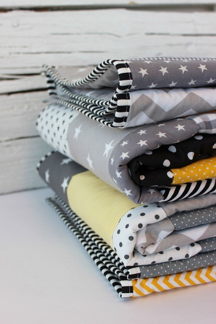 patchwork blanket with black, grey and yellow Kinder