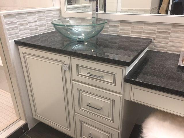 We Installed This Sleek Black Pearl Granite Countertop Polished With Mosaics Black Granite Countertops Granite Bathroom Countertops Country Bathroom Vanities