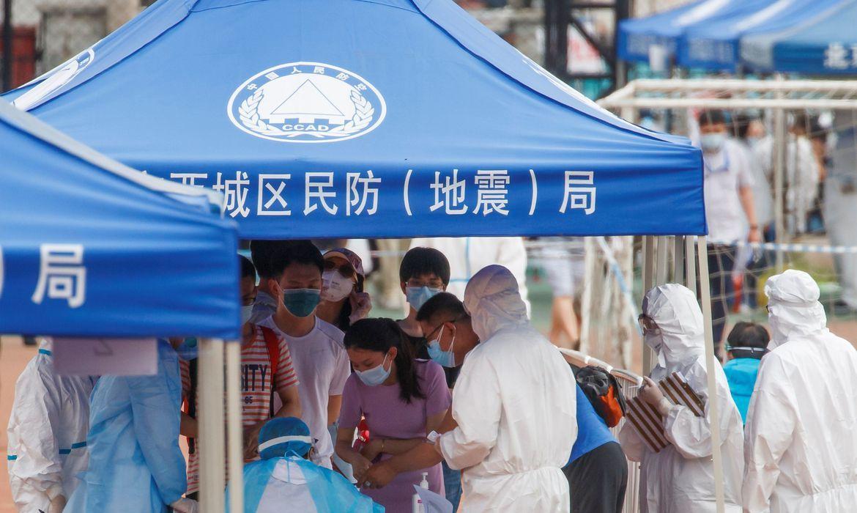 Pequim aumenta capacidade de teste e chega a um terço da