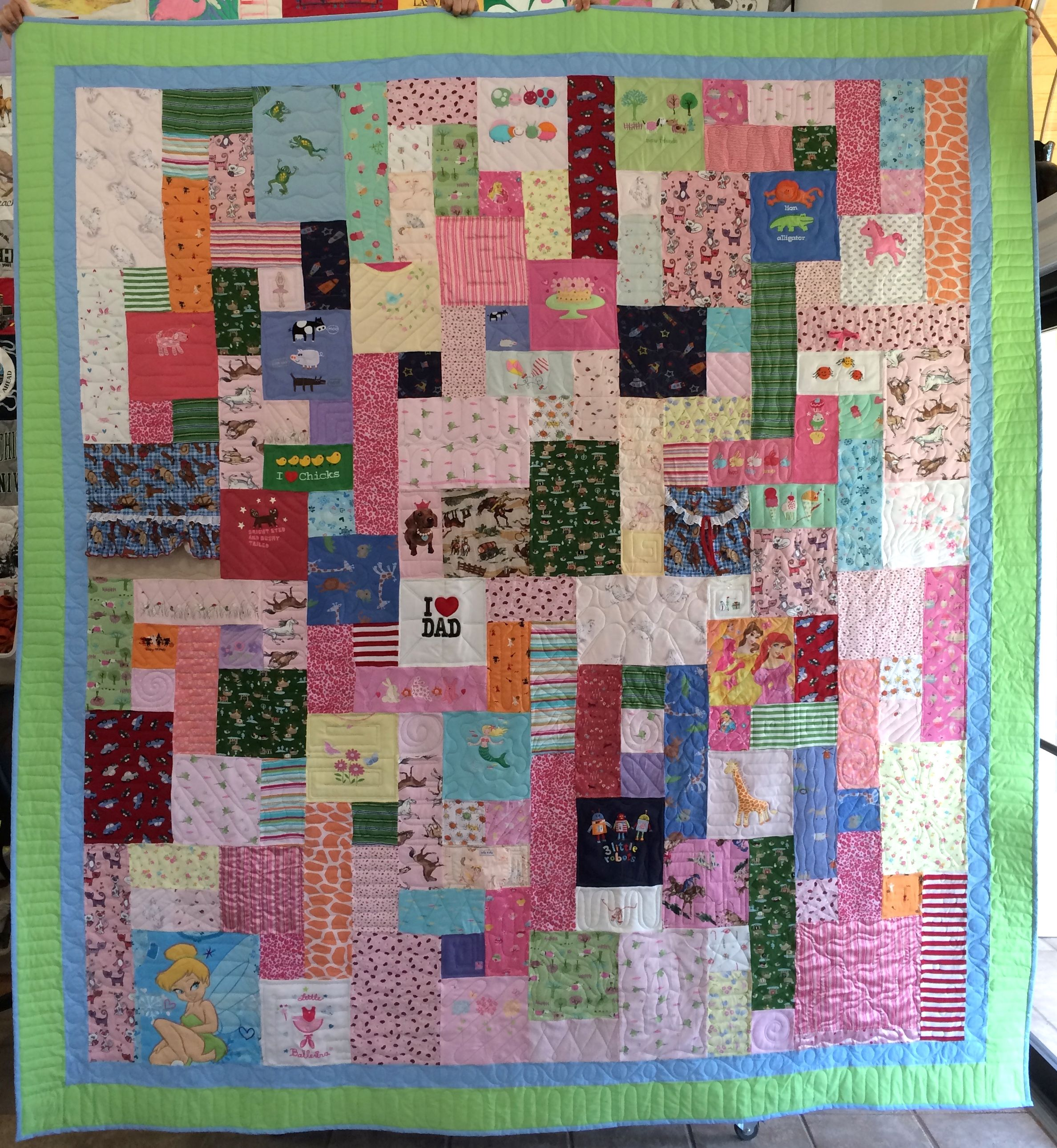 Baby's clothing quilt https://www.toocooltshirtquilts.com/baby