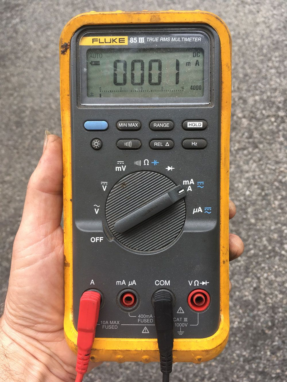 A Multimeter Configured To Measure Current On The High Amperage Setting Red Probe In The A Socket Rotary Dial Turned To T Multimeter Electricity Work Tools