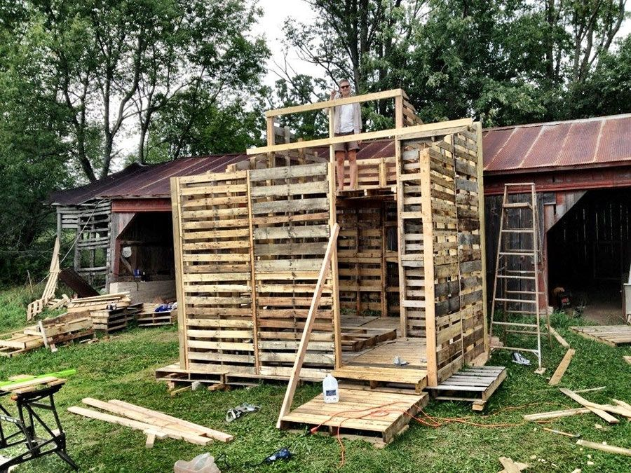 Tiny house under construction made entirely of used pallets