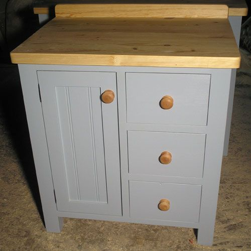Pin by melanie stanley grant on country style kitchen for Tall kitchen drawer unit
