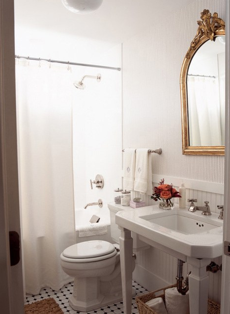 Beautiful French Cottage Bathroom Design With White Pedestal Sink, Gold  Leaf Antique Mirror, Basket, Shower Curtain And Beadboard.