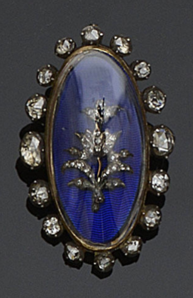 A Georgian diamond and enamel panel  Later mounted as a brooch, of bowed design, the oval blue enamel panel applied with a rose-cut diamond set floral spray, below later glazed panel, within a border of graduated rose and old-cut diamonds in closed foil-backed settings, length 3.7cm.