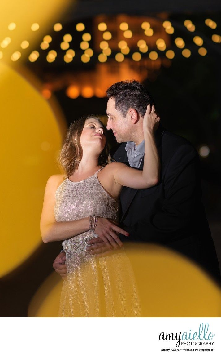 Amy Aiello Photography chicago wedding photographer nighttime  engagement session ideas magical lighting bokeh glow gold