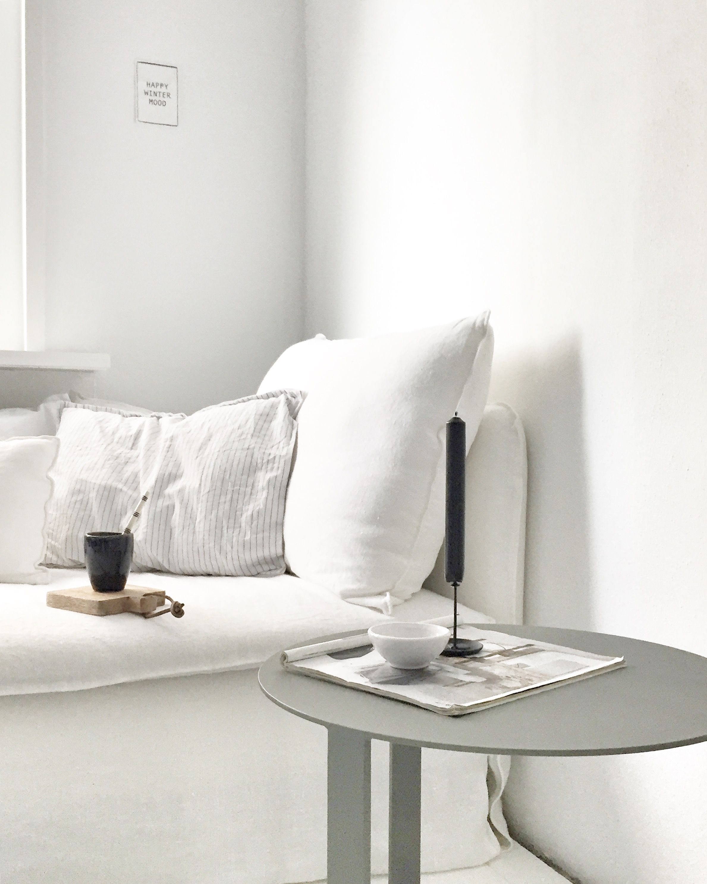 Simple Minimalist Interior White Linen Sofa Round Side Table With A Black Candle For Added Impact Ikea Sod White Linen Sofa Round Sofa Living Dining Room