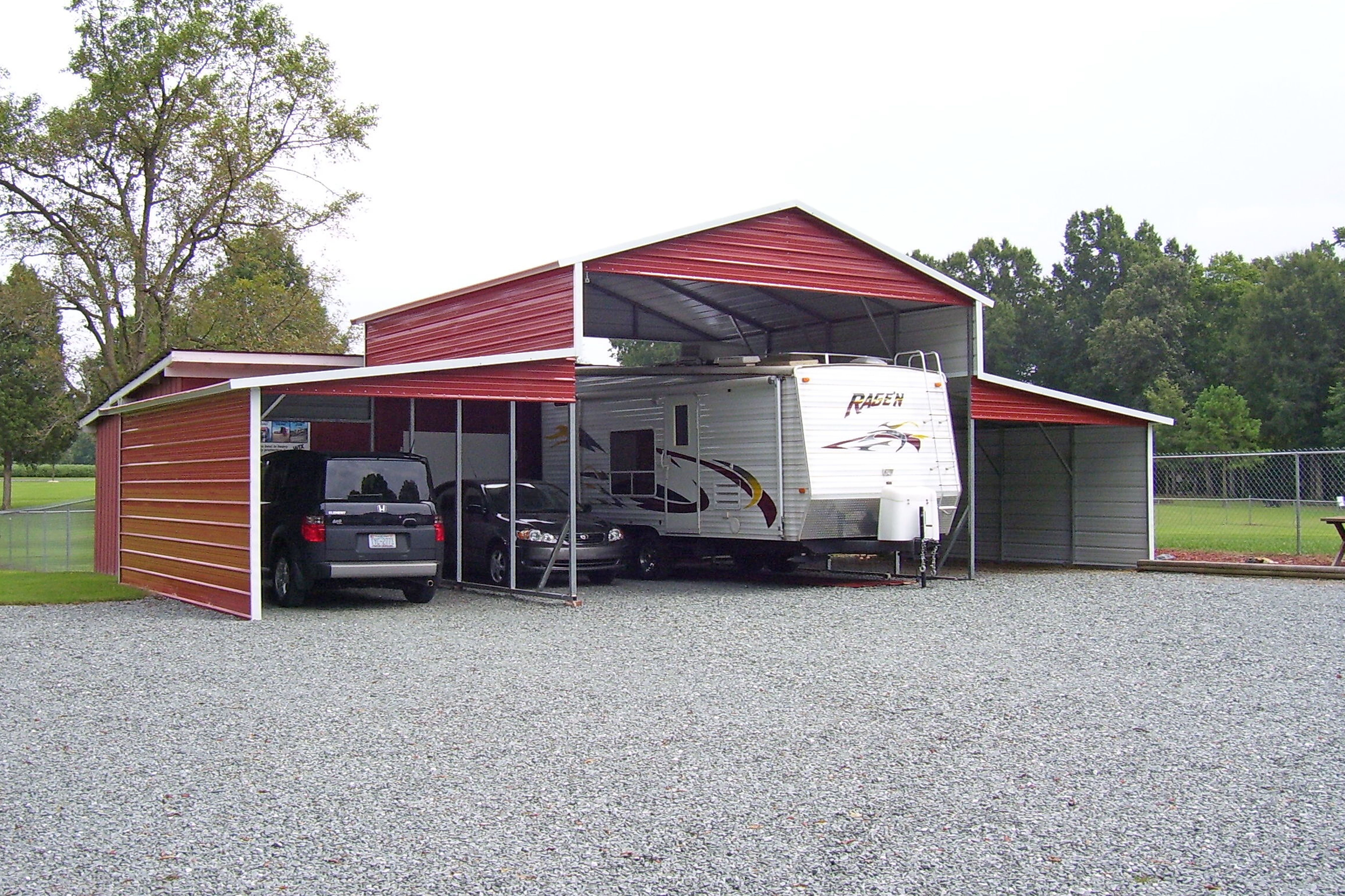 Multi use building red and white trim. RV cover and
