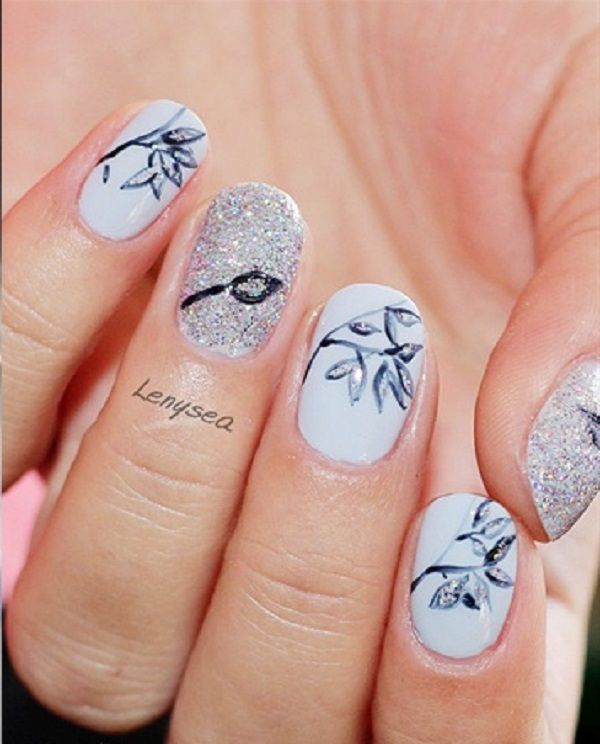 Beautiful black and white leaf nail art design. The white background  compliments the black colored - 35 Leaf Nail Art Ideas Silver Glitter, Feather Nail Art And