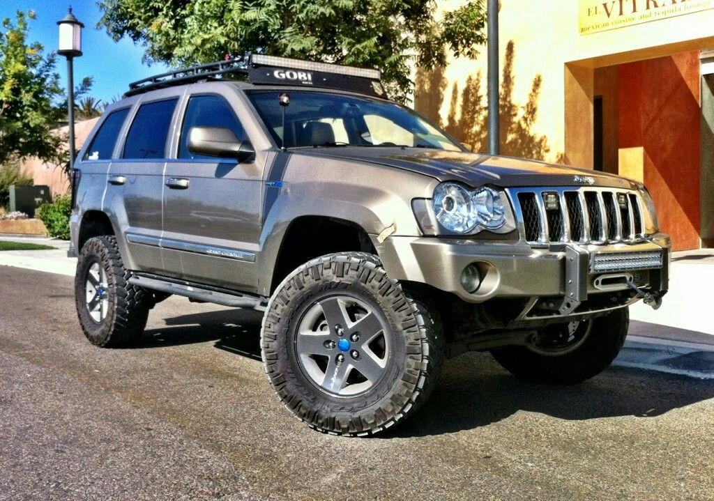 Lifted Jeep Grand Cherokee 05 Wk Jeep Wk Jeep Cars Black Jeep