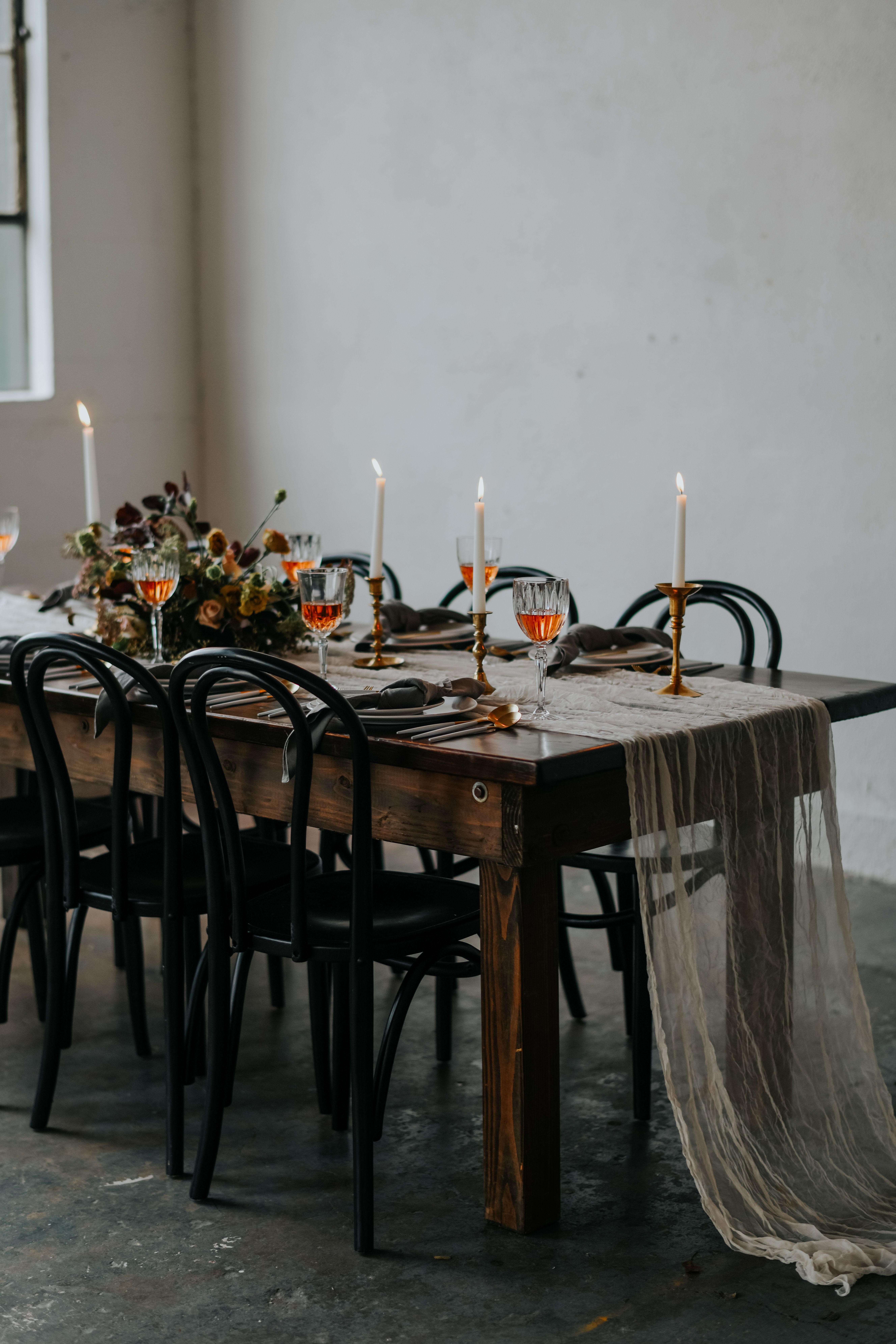 Tablescape With Long Wood Farm Table With Cheesecloth Gauze Runner In Blush With Black Chairs A Table Arrangements Wedding Wedding Chairs Table Runners Wedding