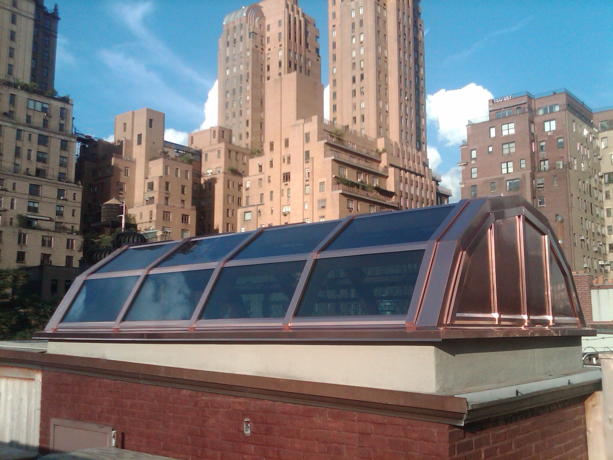Copper Clad Segmented Radiused Skylight Used To Bring Natural Daylight Into A Room Below Skylight Vented Skylights Roof Solar Panel
