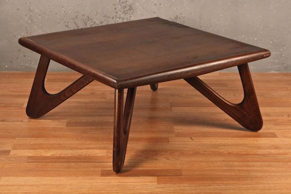 A Stylish Dark Walnut Coffee Table With A Square Surface And Angular  Boomerang Style Legs.