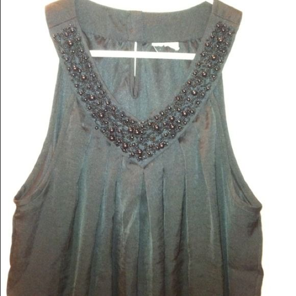 Tank top. Dressy black v neck tank. Black beaded v neck. The tag is cut off but it is a medium! Worn lightly, great condition. Tops Tank Tops