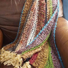 """Showcasing a multicolor woven cotton design, this fringed throw adds eclectic appeal to your favorite chaise or arm chair.  Product: ThrowConstruction Material: CottonColor: MultiFeatures: HandcraftedDimensions: 50"""" x 60"""""""