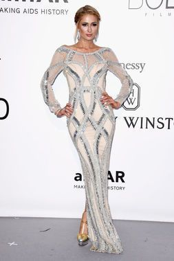 Heiress Paris Hilton stepped onto the amfAR Gala Red Carpet with this chic metallic looking ensemble.