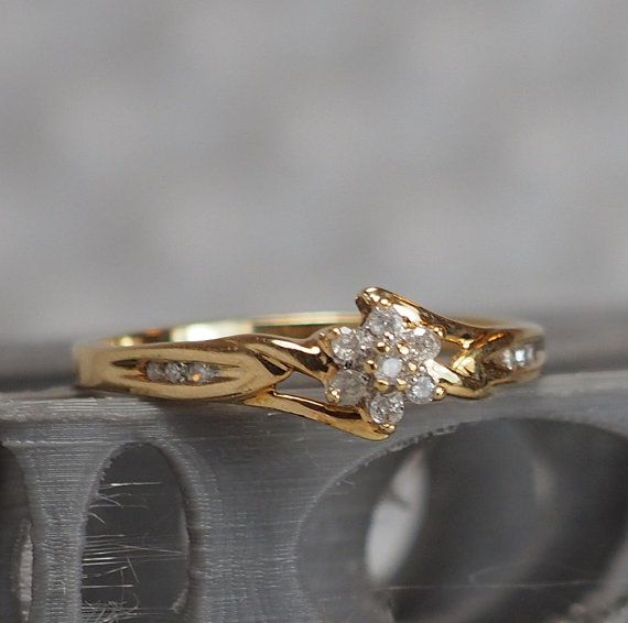 55baf46e448353 Beautiful vintage feminine diamond flower clusters ring set in 10K yellow  gold. This ring has 13 diamonds approximately 1-1.85mm diameter each.