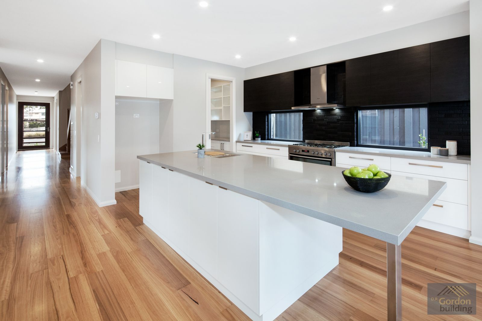 Dual windows with black tiles behind cooker allows ample light to ...
