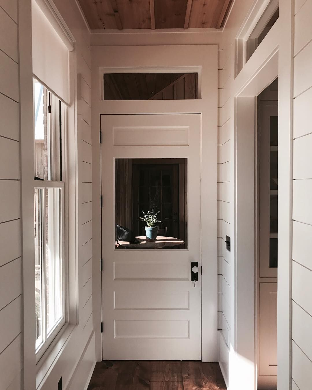 Farmhouse style arched door opening in foyer. panel column