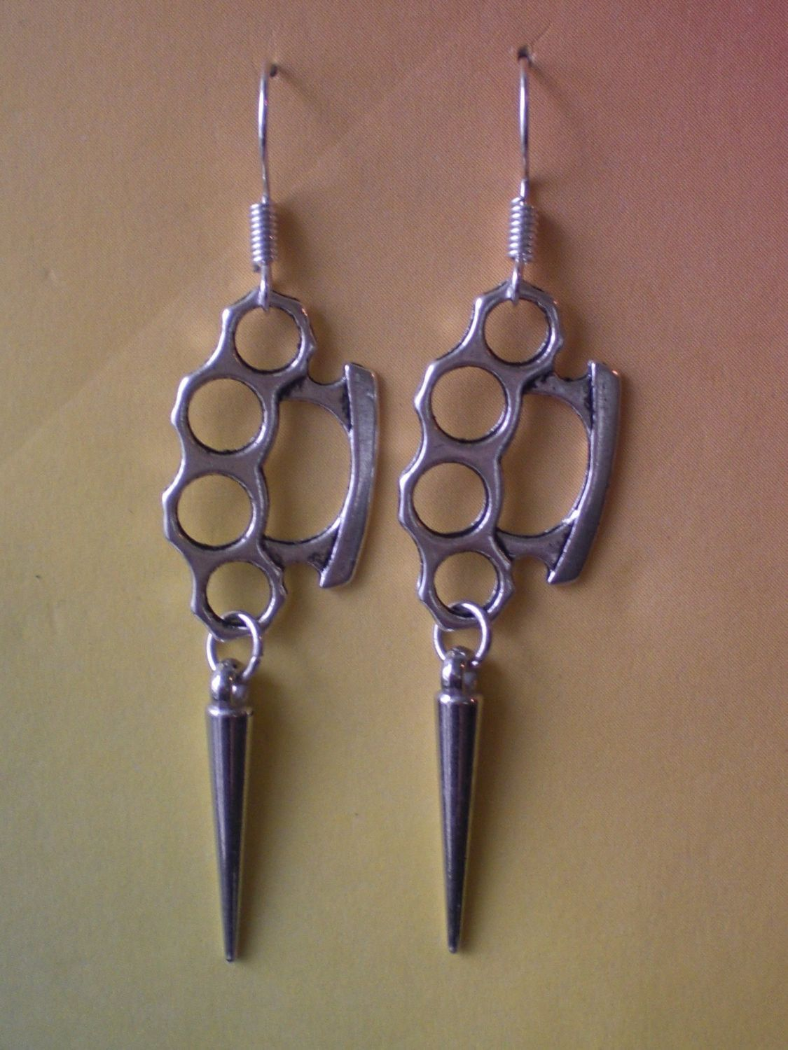 brass knuckle duster and spike earrings punk jewelry gothic
