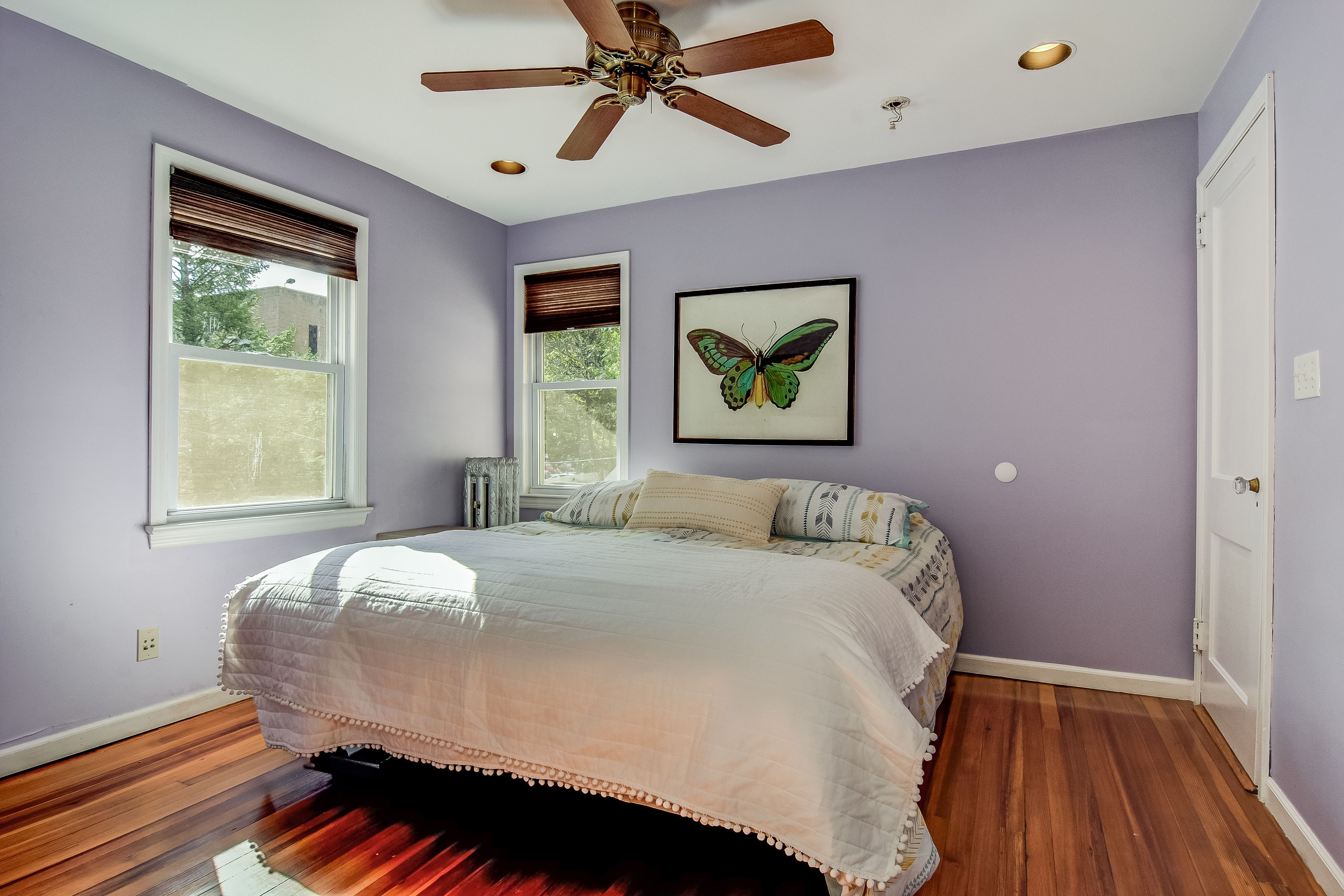 Master bedroom features hardwood floors, natural light and