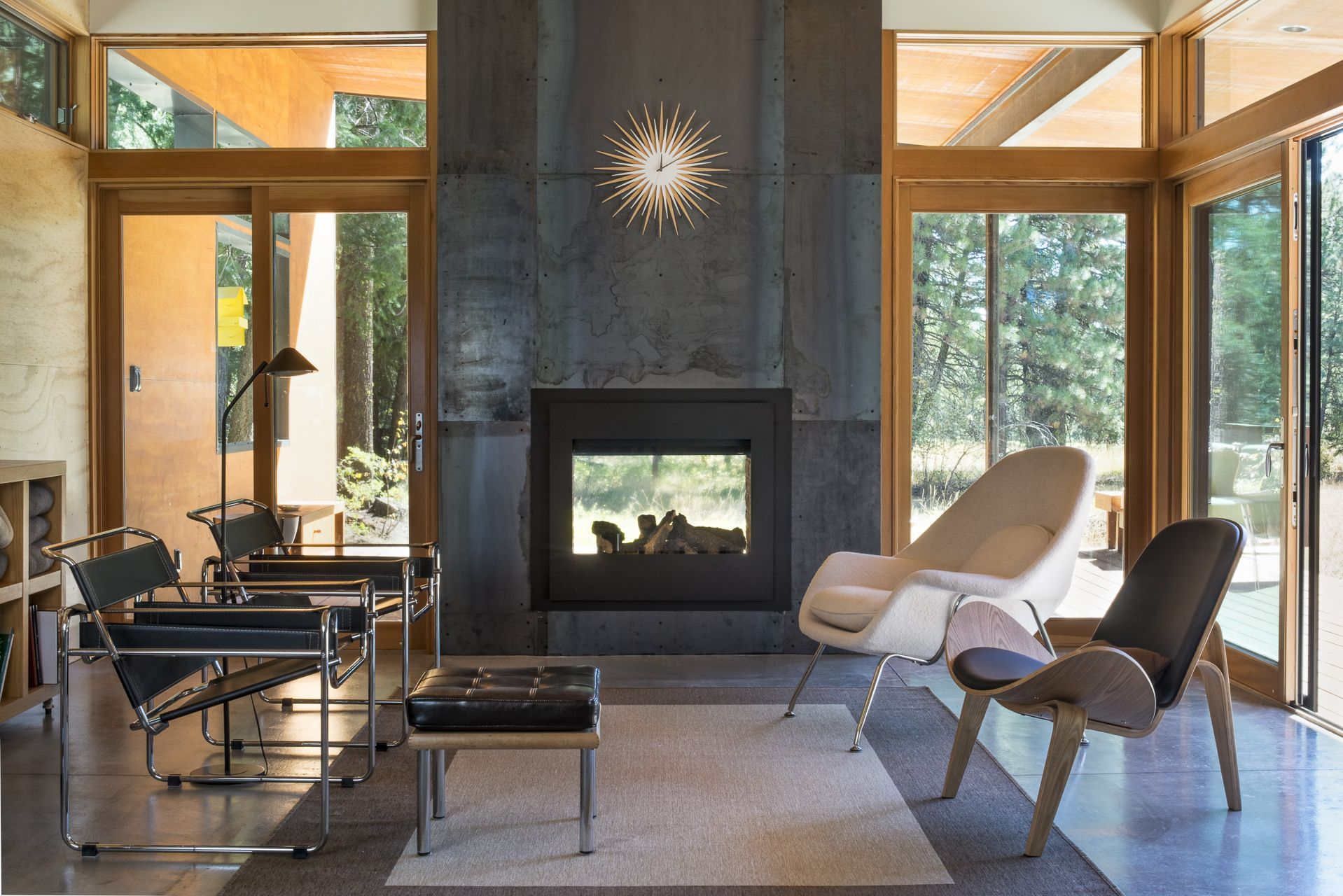 The Interior Living Room On The Reverse Of The Double Sided Fireplace Modern Cabin Indoor Outdoor Fireplaces Modern Fireplace