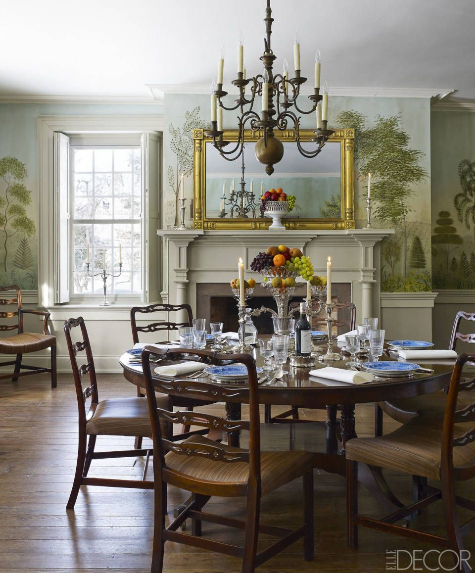 The dining room mural by Elektra Buhalis is painted in the style of the New  England artist Rufus Porter; chairs surround an early Regency-style table,  ...