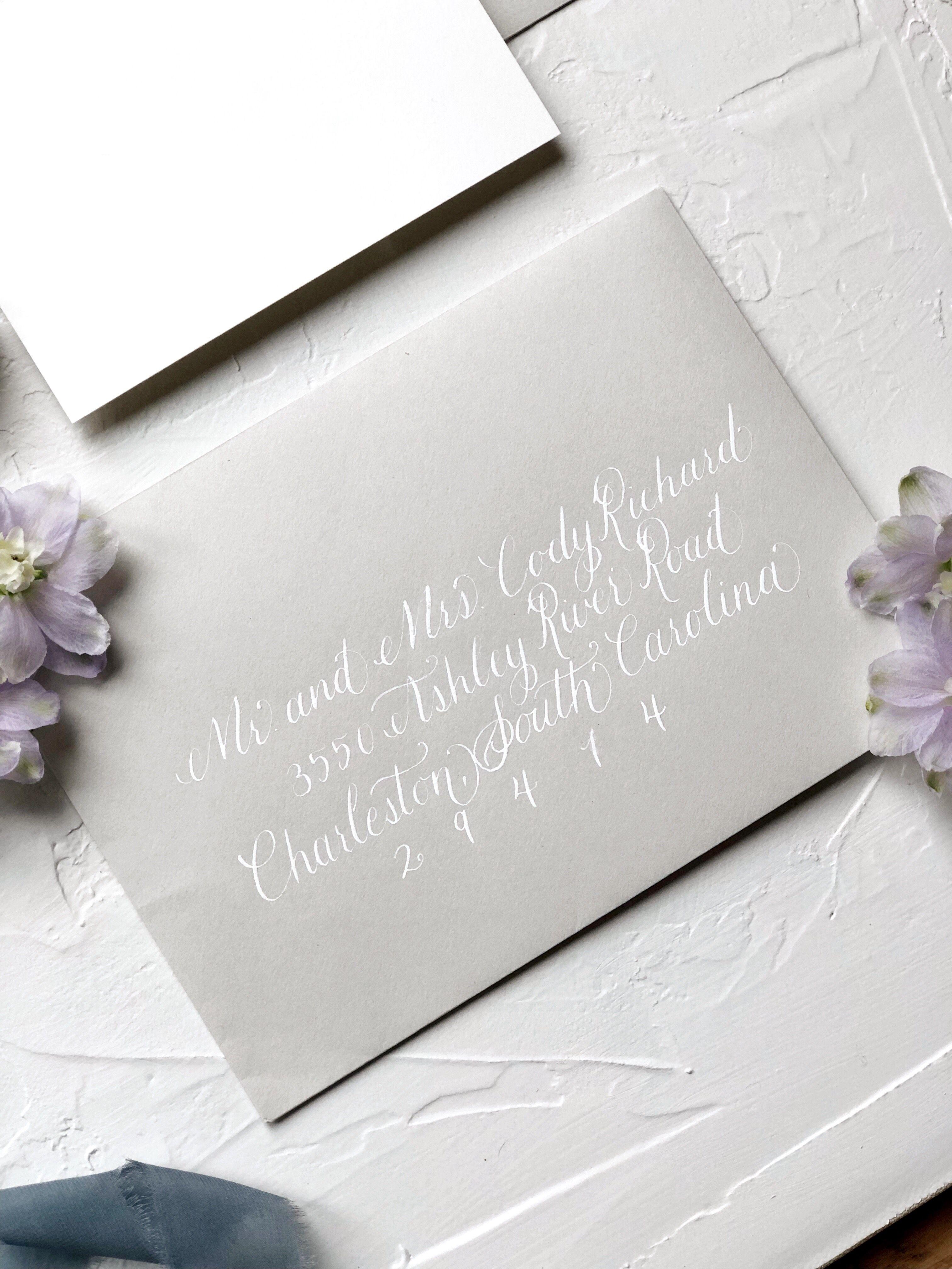 White Calligraphy On Pale Grey Envelopes Wedding Inspiration