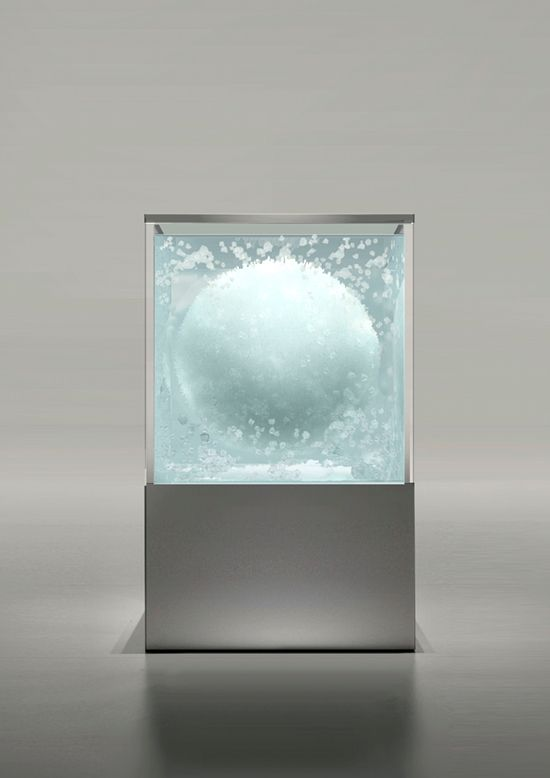 Tokujin Yoshioka, Japanese artist grows a chandelier out of Swarovski crystals in a mineral aquarium bath. Learn more at link.