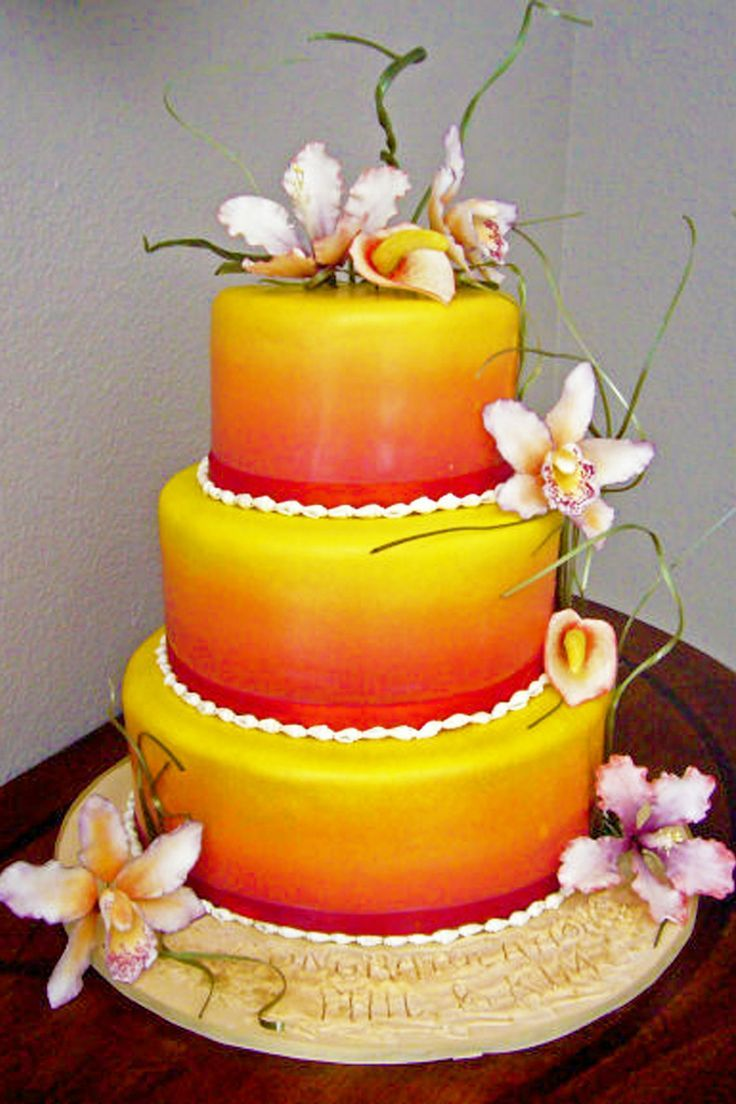 3 tier fondant tropical wedding cake with red, orange and yellow ...
