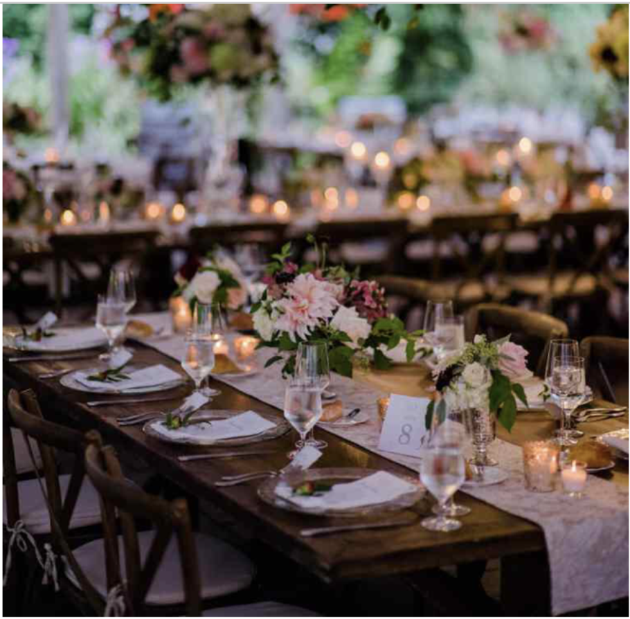1 Floral Centerpiece 2 Smaller Vases Votive Candles Table Number Menu Cards Water Glass Table Runner On Wood Wedding Inspo Table