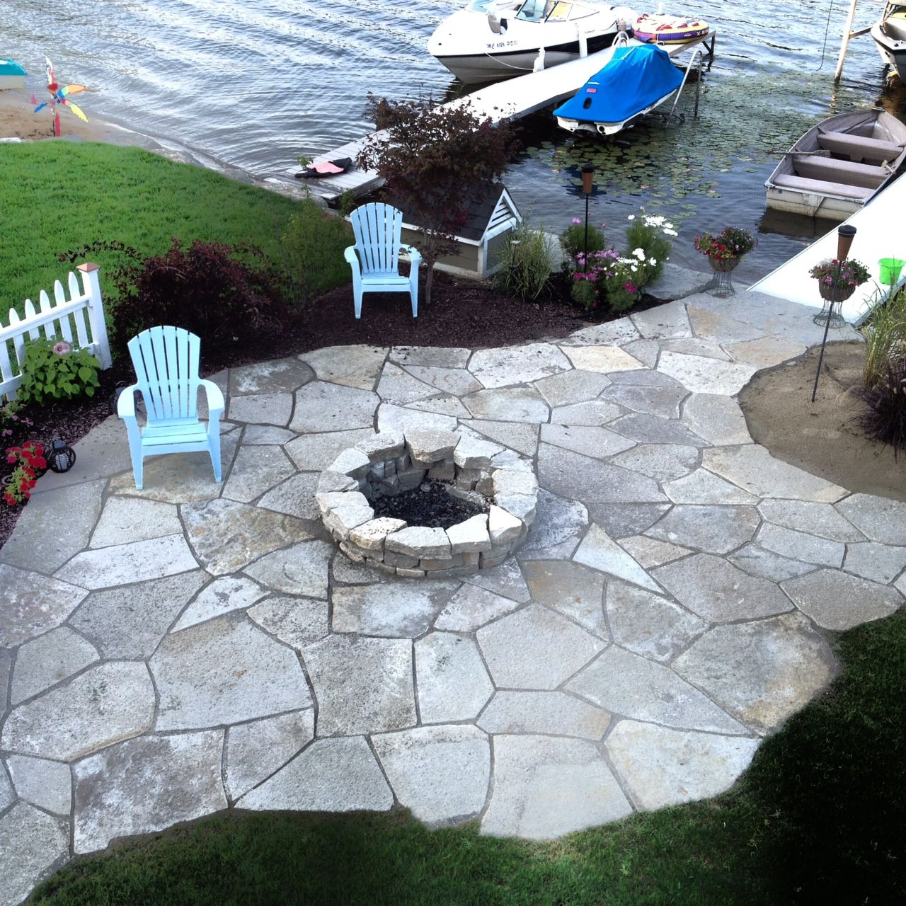 custom limestone patio & fire pit on lobdell lake | fire pits