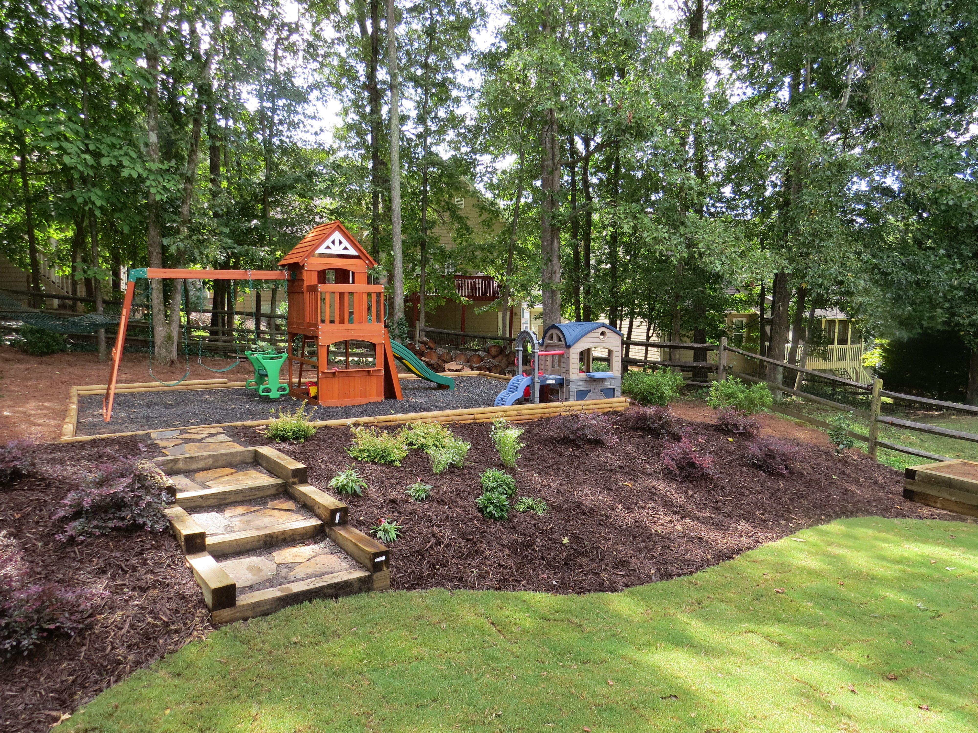 landscaping, landscape installer, install trees, plants  Sloped