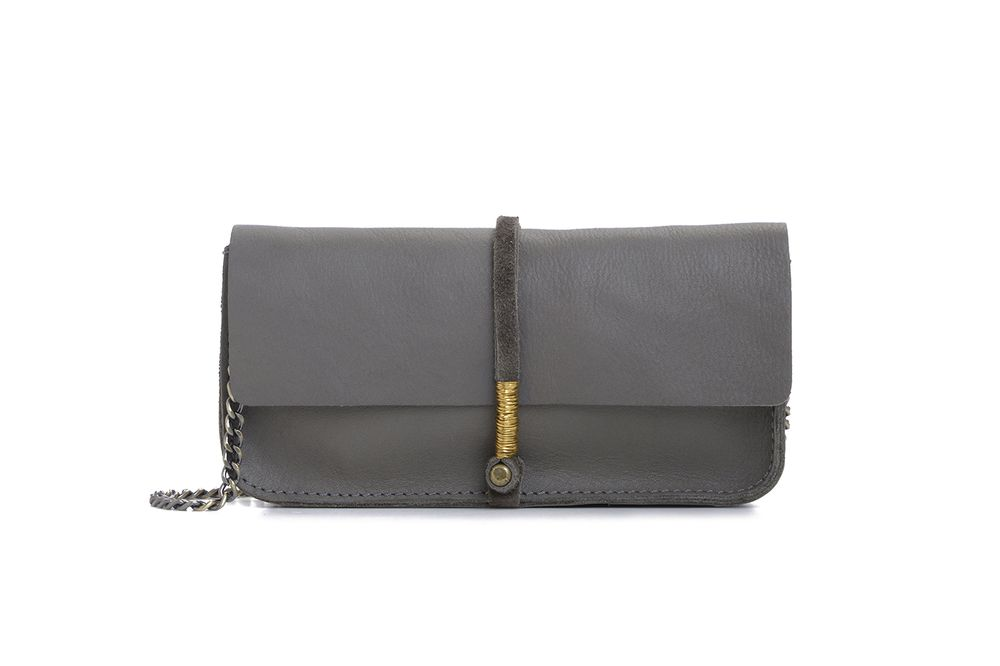 "Leather clutch/wallet with brass details and removable  cross body chain. Hand wrapped wire closure. Interior  zipper pocket.  Great as a wallet or a clutch.   7.75"" x 4"" x 1.25"" .  48"" strap length.      Color: Cement"