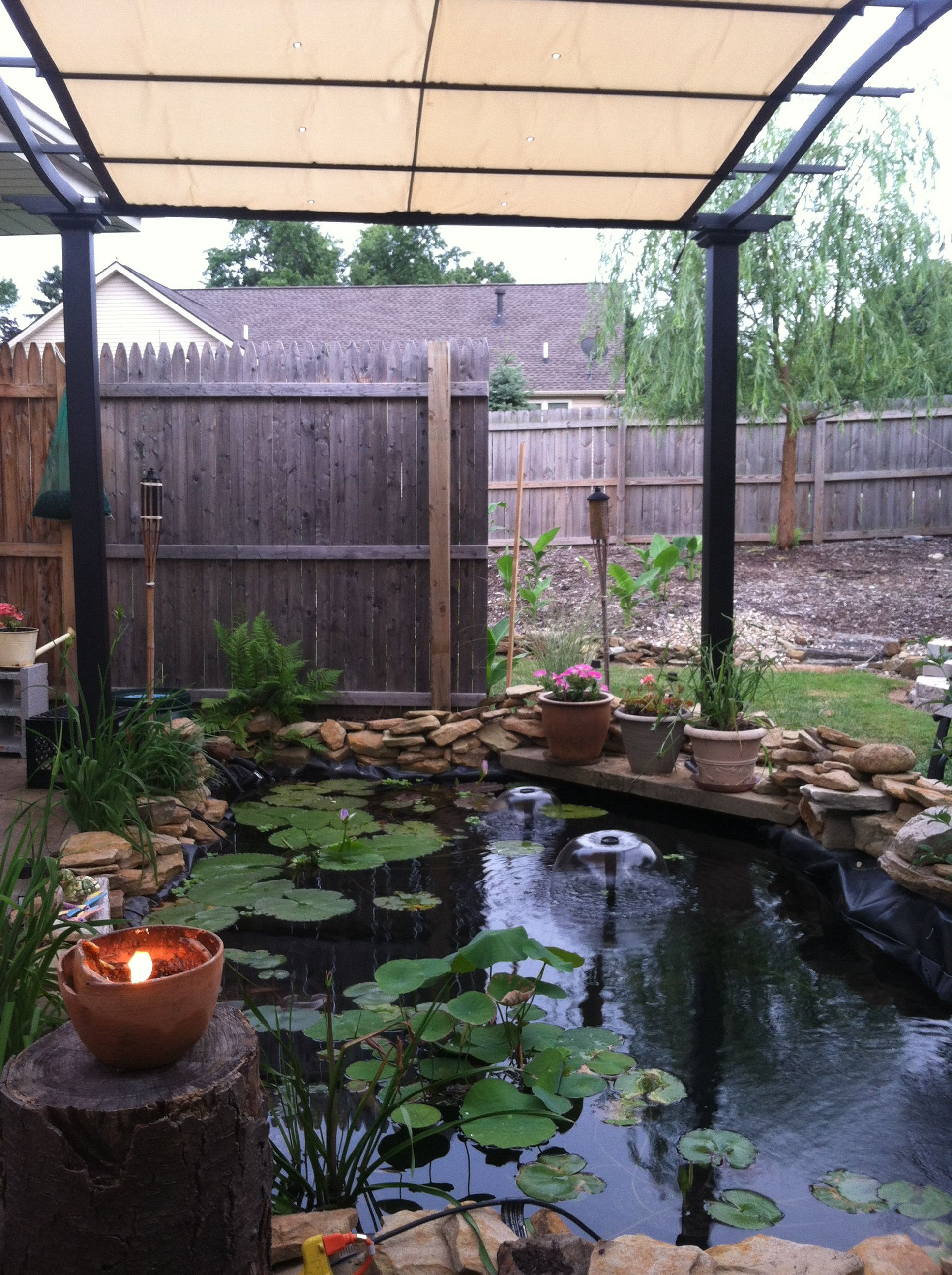 Our new addition pergola over our pond ponds patio for Garden pond water features