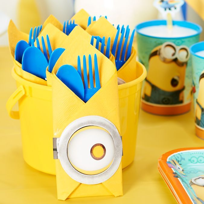Napkins and silverware are essential party basics that can easily be turned into something special! A few special folds and some Paper Minions masks are all you need for this adorable table setting.