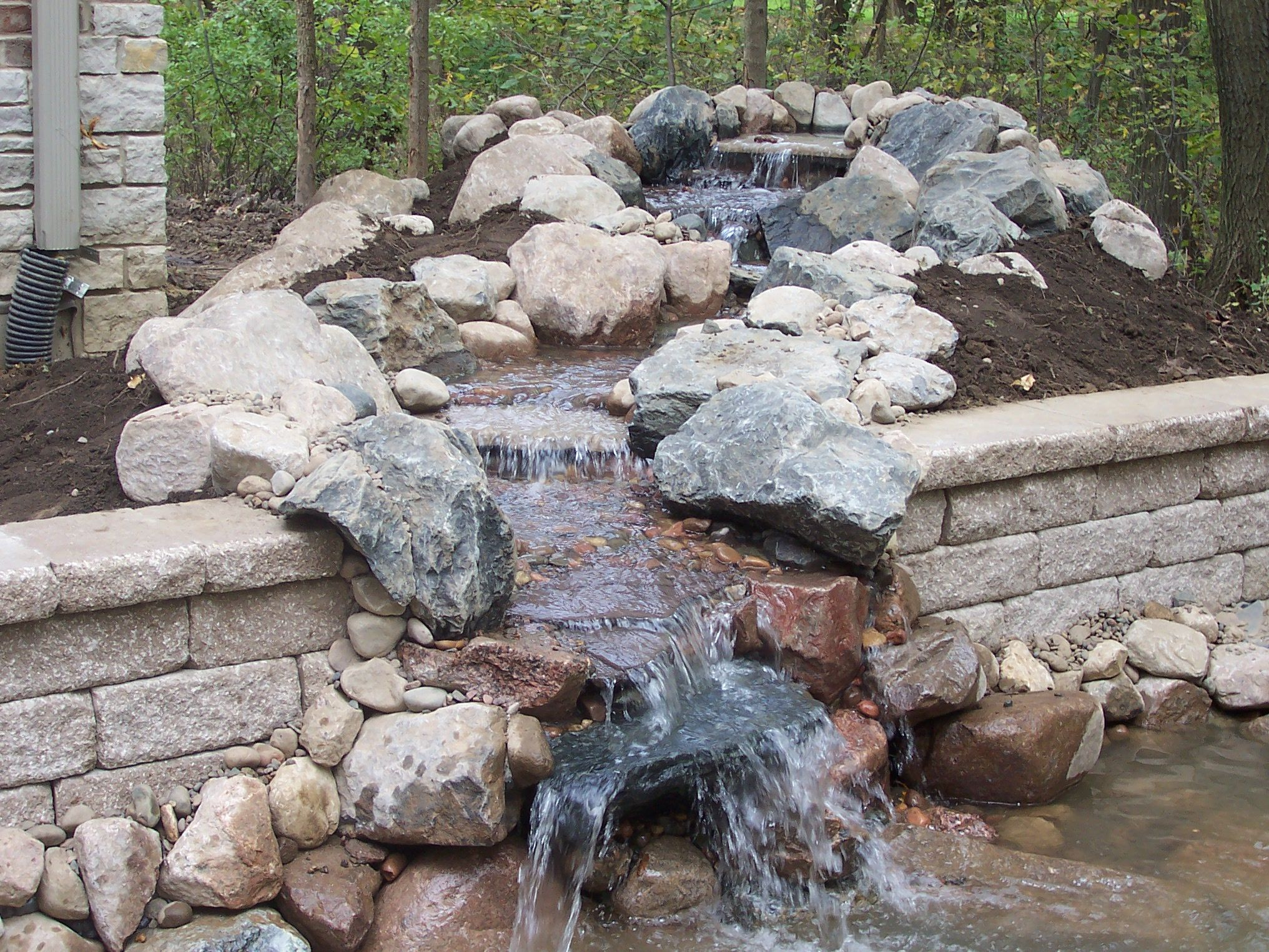 Gallery of back yard waterfalls welcome to backyard for Coy pond waterfall