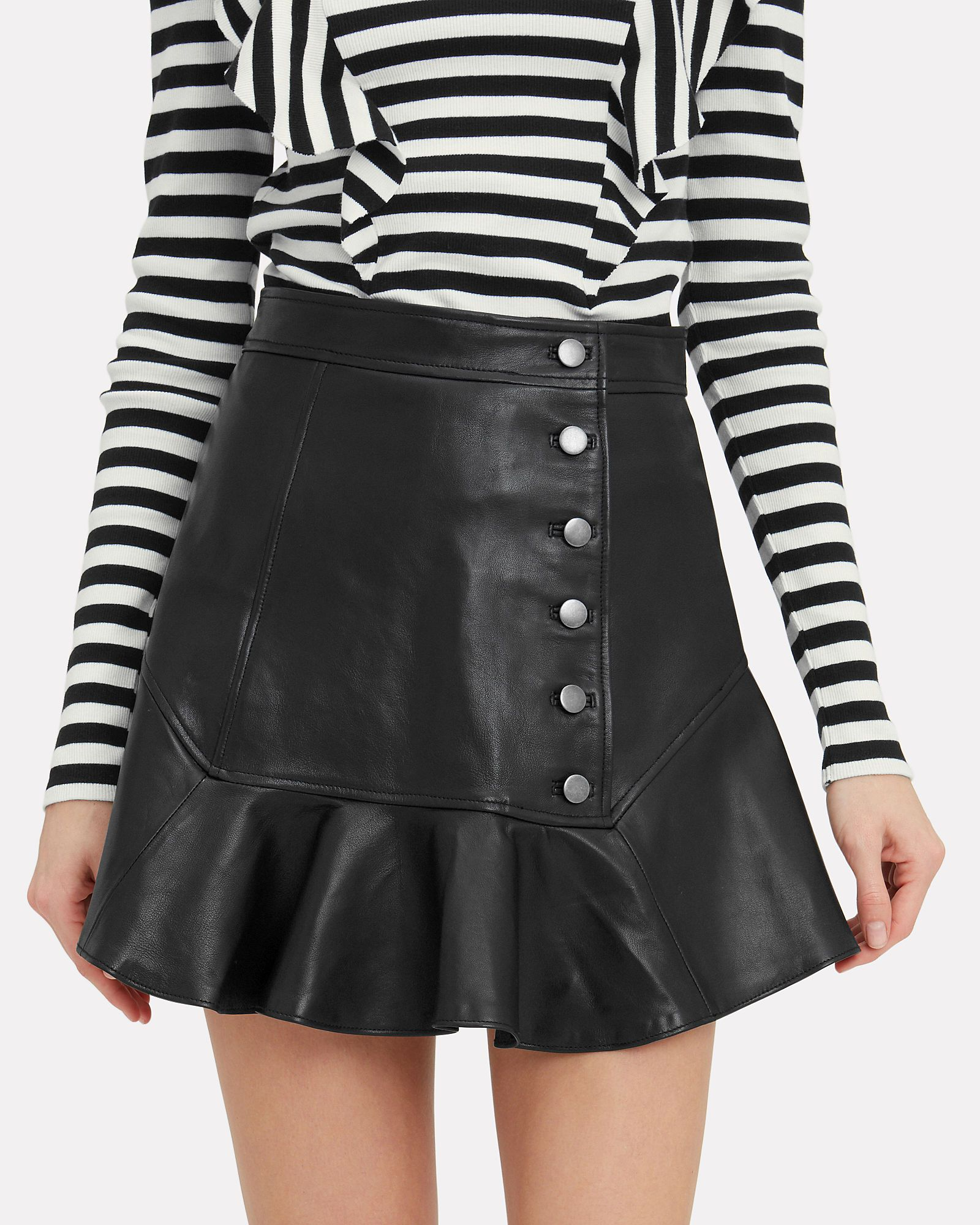 589b311f5 A button-embellished front lends a chic edge to this ruffled hem mini skirt.  Banded waist.