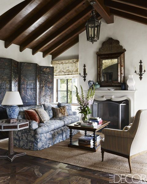 """Julia Reed, """"A Santa Monica Home Inspired By The History of Spain,"""" Elle Decor (April 2015). Design by Michael S. Smith. In the sitting room, the clients' sofa was reupholstered in a fabric by Jasper, and the Napoleon III-style bergère is covered in a Rogers & Goffigon fabric; the Anglo-Indian inlaid games table is from the 19th century, and the rush matting is by Stark."""