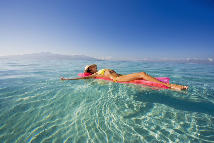 French Polynesia, Tahiti, Moorea, Woman Floating In Water. Poster Print x