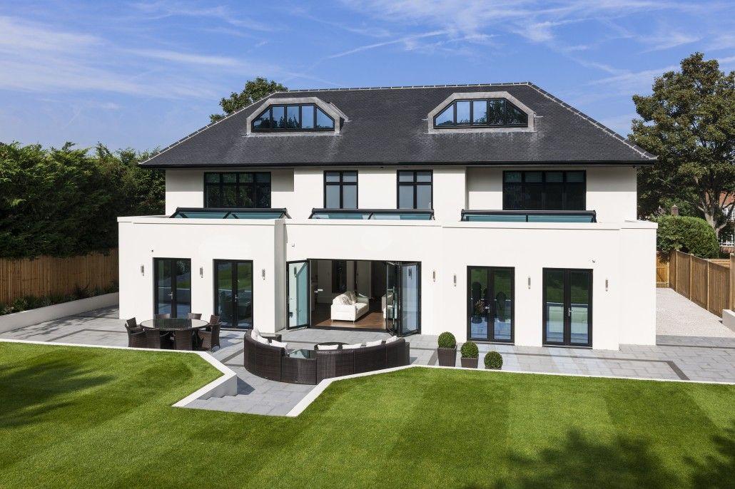 Roofline shot showing black seamless aluminium guttering for House back doors for sale