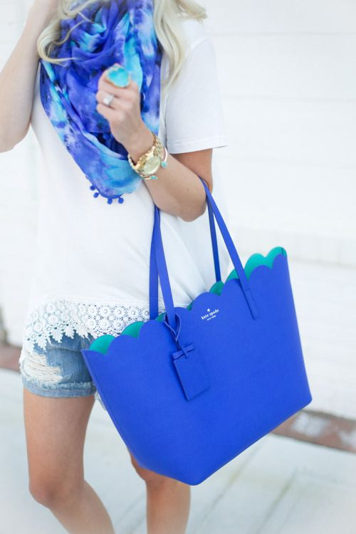 White Top, Light Wash Jean Shorts, Blue Purse, Blue Scarf, Gold Accessories.